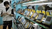 This picture taken on November 13, 2009 shows fake iPhones displayed in a shop at a market known for counterfeit U.S. goods and housed in the metro station connected to the Science and Technology Museum in Shanghai. (PHILIPPE LOPEZ/PHILIPPE LOPEZ/AFP/Getty Images)