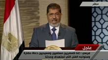 President-elect Mohamed Morsi speaks during his first televised address to the Egypt in this still image from a video, on June 24, 2012. (Egypt TV via REUTERS TV/Reuters)