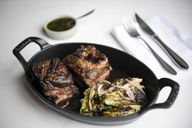 Grilled short ribs with chimichurri and grilled lettuce.