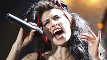 Amy Winehouse performs at the Brit Awards at Earls Court in London February 20, 2008. (ALESSIA PIERDOMENICO/REUTERS/Alessia Pierdomenico (BRITAIN))