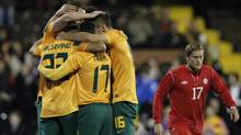 Australia's players celebrates Josh Kennedy's goal against Canada during their international friendly soccer match at Craven Cottage, London, Tuesday, Oct. 15, 2013. (Sang Tan/AP)
