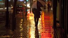 A man walks along Shuter Street during a storm in Toronto on Monday, October 29, 2012. (Matthew Sherwood for The Globe and Mail)