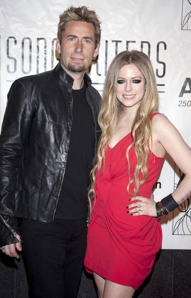 Happily engaged Canadian couple Chad Kroeger and Avril Lavigne are happily engaged at the Songwriters Hall of Fame ceremony in New York last week. Click to the next photo to see a computer-generated image of what the couple will look like after 30 years of marriage. (Carlo Allegri/Reuters)