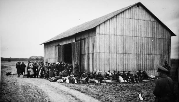 POWs take refuge at a barn along the Great March route.