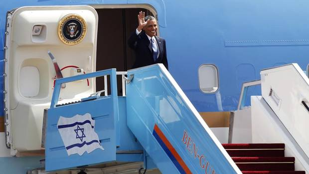 U.S. President Barack Obama waves as he disembarks from Air Force One upon his arrival at Ben Gurion International Airport near Tel Aviv March 20, 2013. Obama said at the start of his first official visit to Israel on Wednesday that the U.S. commitment to the security of the Jewish state was rock solid and that peace must come to the Holy Land. (NIR ELIAS/REUTERS)