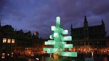 A steel installation, replacing the traditional Christmas tree, is illuminated at Brussels' Grand Place November 29, 2012. The 25-metre-high sculpture was designed by French architects Pier Schneider and Francois Wunschel. (FRANCOIS LENOIR/REUTERS)