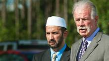 Dove World Outreach Center Pastor Terry Jones, right, and Imam Muhammad Musri from the Islamic Society of Central Florida speak in Gainesville, Fla. (PAUL J. RICHARDS/Paul J. Richards/AFP/Getty Images)