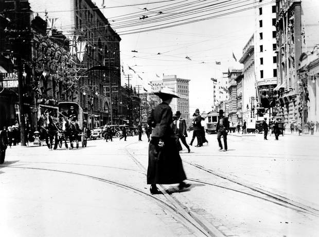 1912: Main Street, looking north from Portage Avenue. Electric streetcar lines, built two decades earlier, crisscross the intersection. (The city's streetcar system was shut down in 1955.)