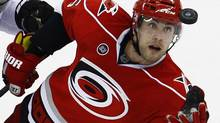 Carolina Hurricanes' Tuomo Ruutu (15), of Finland, reaches for the puck against Los Angeles Kings' Dustin Penner (25) during the third period of an NHL hockey game in Raleigh, N.C., Saturday, Feb. 4, 2012. Carolina won 2-1. (AP Photo/Gerry Broome) (Gerry Broome/AP)