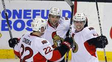 The Ottawa Senators Jean-Gabriel Pageau (R) is congratulalted by teammates Erik Condra (L) and Cory Conacher after Pageau scored a goal against the Boston Bruins in the third period of their NHL hockey game in Boston, Massachusetts April 28, 2013. (BRIAN SNYDER/REUTERS)