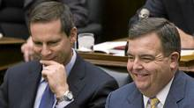 Ontario Finance Minister Dwight Duncan, right, laughs with Ontario Premier Dalton McGuinty, left, after delivering his fall economic update at Queen's Park in Toronto on Thursday, November 18, 2010. (Nathan Denette/Nathan Denette/THE CANADIAN PRESS)