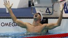 Canada's Benoit Huot celebrates after winning the Men's 200-metre Individual Medley SM10 event during the London 2012 Paralympic Games at the Aquatics Centre August 30, 2012. (Reuters)