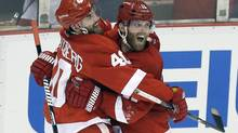 Detroit Red Wings right wing Daniel Cleary, right, celebrates his empty-net goal against the Chicago Blackhawks with teammate Henrik Zetterberg (40), of Sweden, during the third period in Game 4 of the Western Conference semifinals in the NHL Stanley Cup playoffs in Detroit, Thursday, May 23, 2013. (Paul Sancya/AP)