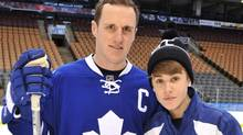 Justin Bieber poses for a photo with Maple Leafs captain Dion Phaneuf Wednesday Dec. 21, 2011, in Toronto. Bieber joined the Toronto Maple Leafs to skate with the Childrens Wish Foundation Of Canada. CP/ HO- MuchMusic (MuchMusic/CP)