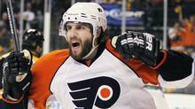 Philadelphia Flyers' Simon Gagne celebrates his go-ahead goal in the third period of Game 7 of a second-round NHL playoff hockey series against the Boston Bruins, Friday, May 14, 2010, in Boston. The Flyers won 4-3. (AP Photo/Michael Dwyer) (Michael Dwyer)
