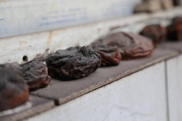 Dried persimmons now frequently turn black, which residents say is due to the thick smog that plagues their village.