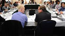 Finance Minister Jim Flaherty, right, takes part in his fifth annual summer policy retreat in Wakefield, Que., last August. (Sean Kilpatrick/The Canadian Press)