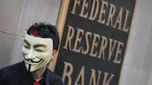 A demonstrator with Occupy Chicago stands outside the Federal Reserve Bank building October 5, 2011 in Chicago (Scott Olson/2011 Getty Images)
