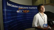Moe Sihota speaks to reporters after being elected B.C. NDP president at their convention in Vancouver on Nov. 29, 2009. (Darryl Dyck/The Canadian Press)