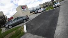 Fresh road work is seen in front of Mayor Rob Ford's family business in Etobicoke on Wednesday. (Kevin Van Paassen/The Globe and Mail)