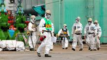 Workers walk near the No.4 reactor of the Tokyo Electric Power Co (TEPCO)'s tsunami-crippled Fukushima Daiichi nuclear power plant in Fukushima prefecture, in this photo released by Kyodo, March 1, 2013, ahead of the second-year anniversary of the March 11, 2011, earthquake and tsunami. French energy group Areva said it was preparing to send nuclear fuel to Japan for the first time since the Fukushima disaster, a sign of possible restarts of idled Japanese reactors. (KYODO/REUTERS)