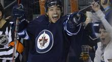 Winnipeg Jets' Zach Redmond celebrates his goal against the Toronto Maple Leafs during the second period of their NHL hockey game in Winnipeg February 7, 2013. (FRED GREENSLADE/REUTERS)