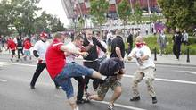 Polish and Russian soccer fans clash outside the National Stadium in Warsaw, June 12, 2012. (JERZY DUDEK/REUTERS)