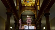 Ontario Premier Kathleen Wynne took some time for a media availability at Queen's Park in Toronto on Aug. 28, 2013. She answered questions about her upcoming trip to Ontario's north, her government's performance through the gas plant scandal, and was even asked wether she had ever smoked marijuana. (Peter Power/The Globe and Mail)