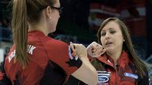 Canada skip Rachel Homan and second Alison Kreviazuk tap fists as they play Scotland at the Ford World Women's Curling Championships in Saint John, N.B. on Tuesday, March 18, 2014. THE (Andrew Vaughan/CANADIAN PRESS)