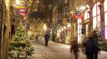 Shoppers and tourists walk in Quartier Petit Champlain in Old Quebec City, on December 22, 2010. A BMO holiday outlook suggests Canadians' spending spirits have improved this season, with the bank projecting an average 15-per-cent jump in holiday spending over last Christmas. (Jacques Boissinot/THE CANADIAN PRESS)