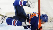Edmonton Oilers' Taylor Hall crashes into the Chicago Blackhawks net during third period NHL action in Edmonton on Saturday, November 19, 2011. (John Ulan/THE CANADIAN PRESS)