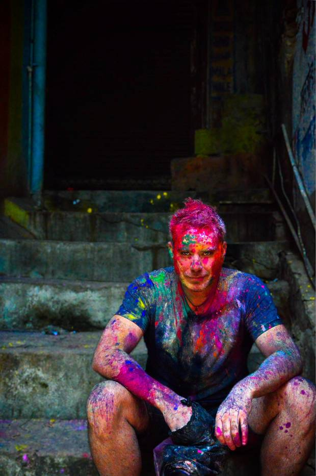The author, Graeme McRanor, sits in a stairwell, face smeared with paint.