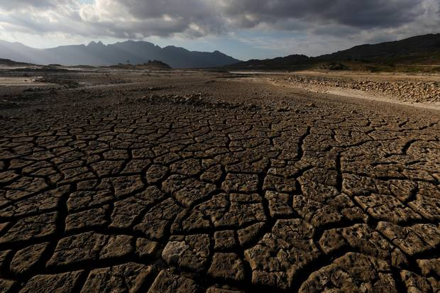Sand blows across a normally submerged area at Theewaterskloof dam near Cape Town Jan. 21, 2018.