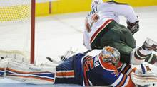 Minnesota Wild Dany Heatley flies over Edmonton Oilers' goalie Nikolai Khabibulin during the overtime NHL hockey shootout in Edmonton on Wednesday, November 30, 2011. The game marked 1,000th shootout in the NHL. THE CANADIAN PRESS/John Ulan (John Ulan/CP)