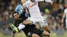 This is a Saturday, Dec. 17, 2011 file photo of Fulham's Clint Dempsey, right, as he challenges for the ball with Bolton Wanderers' Mark Davies during their English Premier League soccer match at Fulham's Craven Cottage stadium in London. (Alastair Grant/AP)