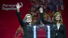 Newly elected Liberal Party leader Kathleen Wynne, left, is congratulated by fellow candidate Sandra Pupatello during the Ontario Liberal Party leadership convention in Toronto, Ont. Saturday, January 26, 2013. Wynne won the leadership bid becoming the first female Premier of Ontario. (Kevin Van Paassen/The Globe and Mail)
