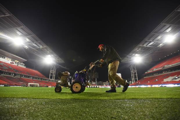 After the Grey Cup game, the ground crew worked late into the night measuring and painting lines on the field for the MLS match between Toronto and Montreal.