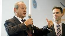 Egyptian billionaire Naguib Sawiris, shown with Anthony Lacavera, chairman of Wind Mobile, bankrolled Wind Mobile in its early days as it bid for licenses and built its network across Canada. He later regretted his decision. (Sarah Dea/The Globe and Mail)