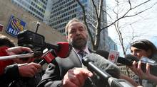 NDP and Official Opposition Leader Thomas Mulcair speaks to the media Monday regarding the Conservative's Temporary Foreign Workers program in front of the RBC offices in Montreal, April 8, 2013. (Christinne Muschi for The Globe and Mail)
