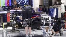 Red Bull technicians work on Red Bull driver Sebastian Vettel's car at the Catalunya racetrack in Montmelo, near Barcelona, Spain, Thursday, May 8, 2014. The Formula One race will be held on Sunday. (Luca Bruno/AP Photo)