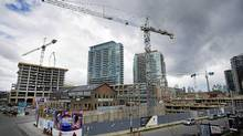 Workers are seen at a condo development in Toronto's Liberty Villiage area. (Kevin Van Paassen/The Globe and Mail/Kevin Van Paassen/The Globe and Mail)