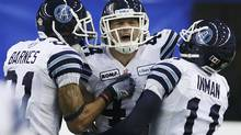 Toronto Argonauts Chad Kackert celebrates his touchdown with Jason Barnes (L) and Dontrelle Inman (R) during against the Montreal Alouettes during the second half of the CFL's Eastern Conference Final football game in Montreal, November 18, 2012. (Christinne Muschi/REUTERS)