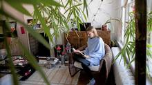 Samantha Nutt, a medical doctor and founder and executive director of War Child, reads in her home in Toronto on Feb. 13, 2012. (Matthew Sherwood for The Globe and Mail)