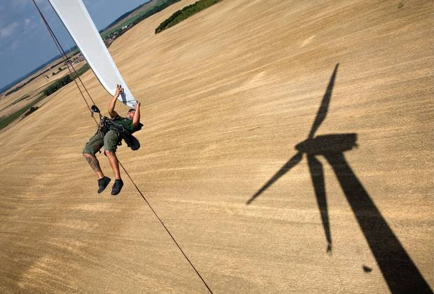 An engineer attends to a wind turbine blade at the Angermuende Wind Farm in Germany. 2006. Germany's renewable energy sector is among the most innovative and successful worldwide. By 2050 the country aims to power itself almost entirely on renewable sources including solar, wind and biomass energy.