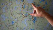 A scientist gestures to a map of the Experimental Lakes Area near Kenora, Ont., on Nov. 1, 2012. (FRED LUM/THE GLOBE AND MAIL)