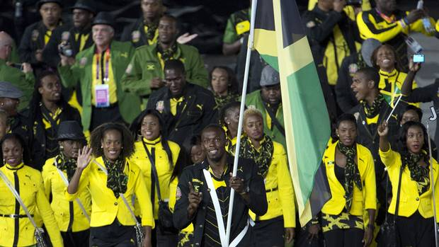Jamaican sprinter Usain Bolt leads the team into the stadium during the opening ceremonies for the 2012 Olympic Games Friday, July 27, 2012 in London (Sean Kilpatrick/The Canadian Press)