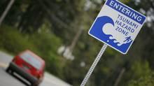 An April 2007) file photo shows a tsunami hazard warning sign located west of Sooke, B.C. (Deddeda Stemler/Deddeda Stemler for The Globe and Mail)