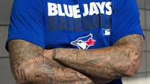 Toronto Blue Jays pitcher Sergio Santos shows off his tatoos at Jays Spring Training in Dunedin, Fla. on Tuesday. (Frank Gunn/The Canadian Press)
