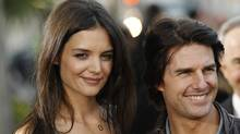 Tom Cruise and Katie Holmes arrive at the premiere of the television series The Kennedys in Beverly Hills, Calif., March 28, 2011. (MARIO ANZUONI/REUTERS)