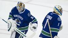 A dejected looking Vancouver Canucks' goalie Roberto Luongo skates past Cory Schneider after Luongo was pulled last April. (JOHN LEHMANN/JOHN LEHMANN/The Globe and Mail)